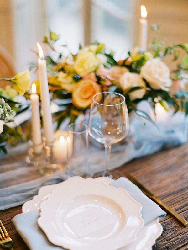 Elegant ivory peach rose blue wedding tablescape