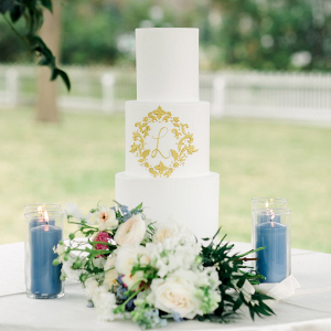 Elegant wedding cake with gold monogram
