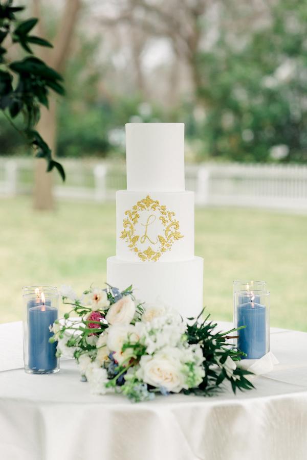 Elegant wedding cake with gold monogram