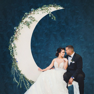 Bride and groom on moon backdrop