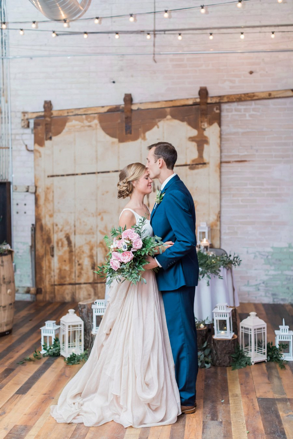 Bride and groom at industrial reception