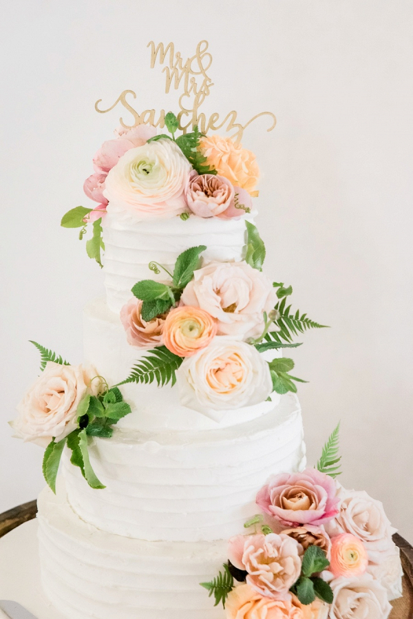 Peach and pink floral wedding cake