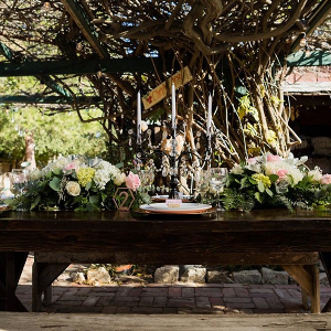 Farm table at rustic pink wedding