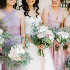 Bridesmaids in mismatched blush and lavender dresses