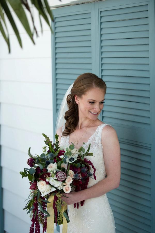 Bride holding burgundy bouquet