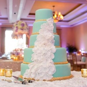 Aqua wedding cake with cascading petals