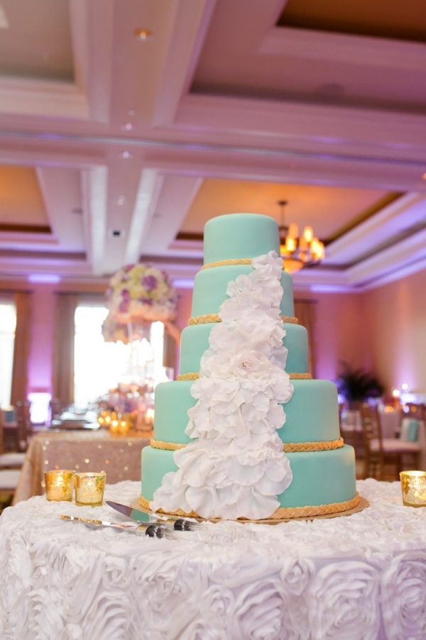 Aqua wedding cake with cascading petals