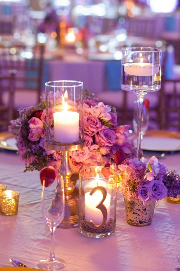 Glamorous purple centerpiece with candles