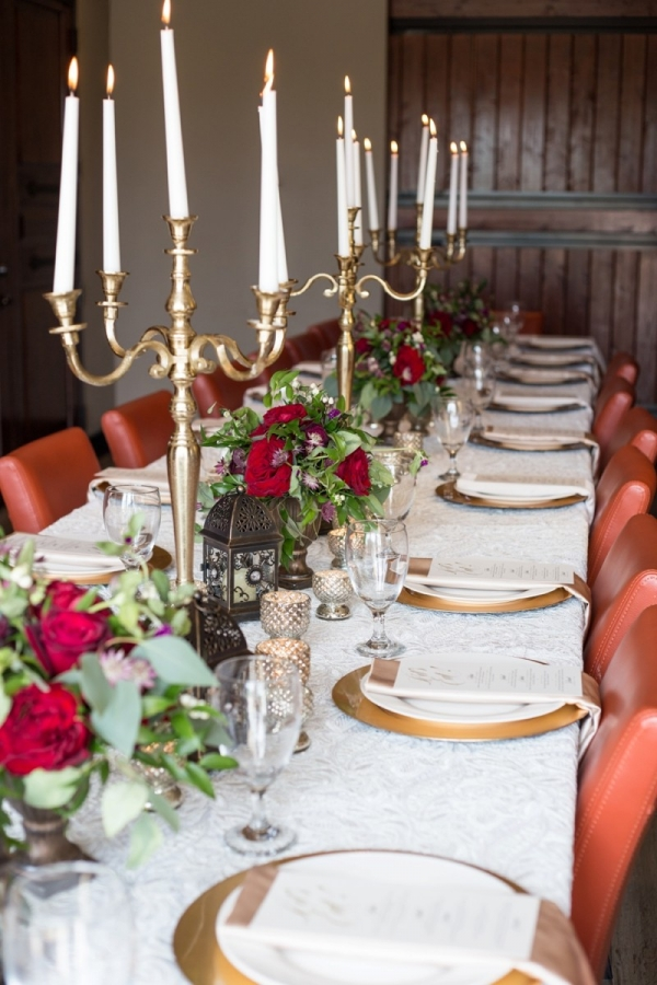 Red and white table scape with candelabra