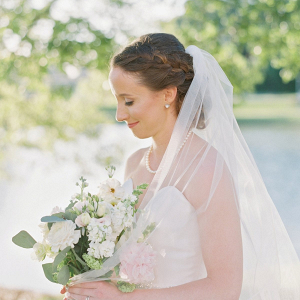 Bride with braided updo and cathedral veil