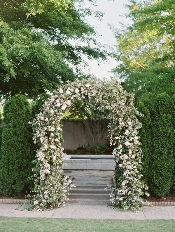 Greenery and rose floral arch