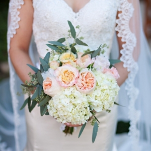 White and blush bouquet with a lace veil