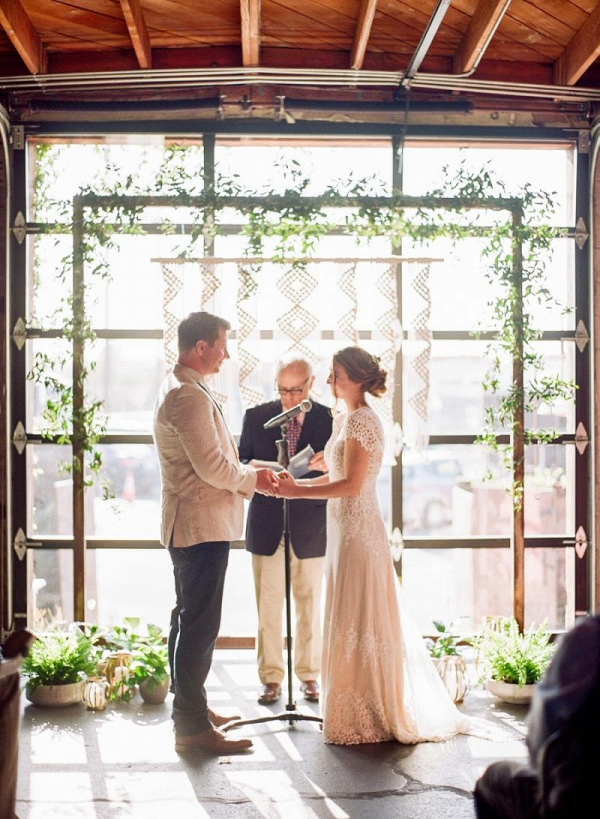Macrame and greenery ceremony backdrop