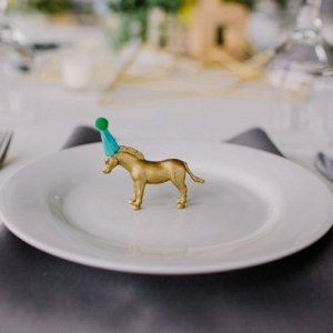 Gold animal place setting on Every Last Detail