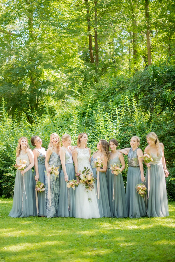 Bridesmaids in light teal tulle dresses
