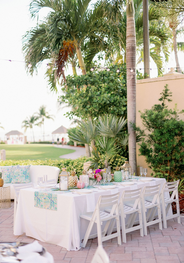 Colorful tropical beach wedding reception
