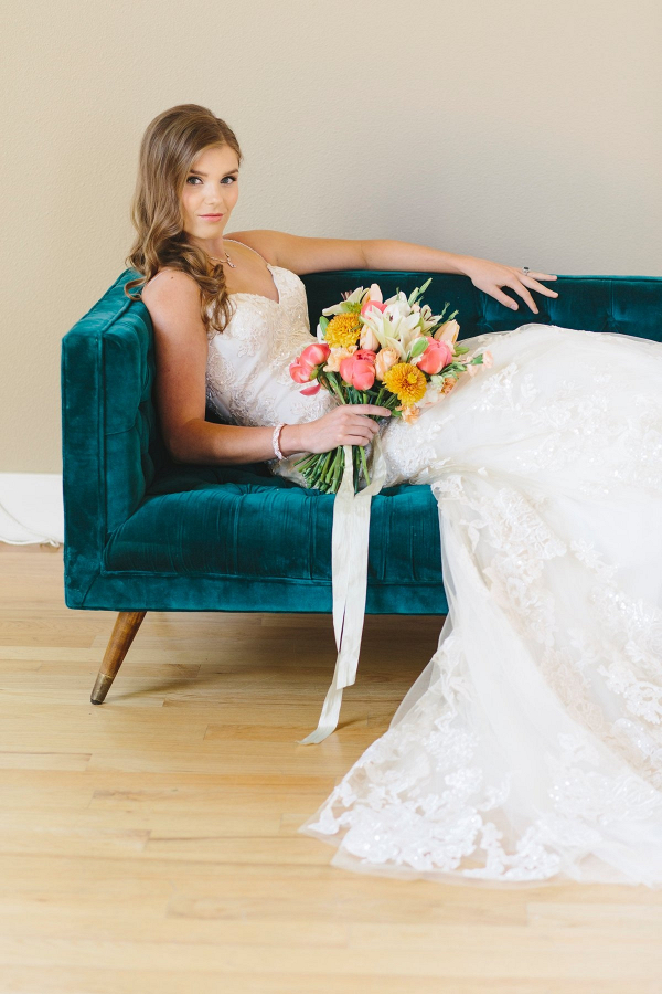 Modern bride on teal velvet couch