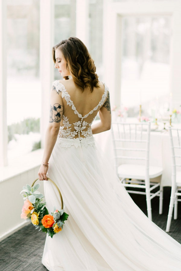 Bride in illusion lace back wedding dress