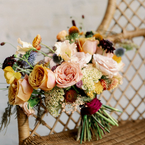 Gold, peach, and maroon bridal bouquet