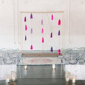 Modern wedding ceremony with tassel backdrop