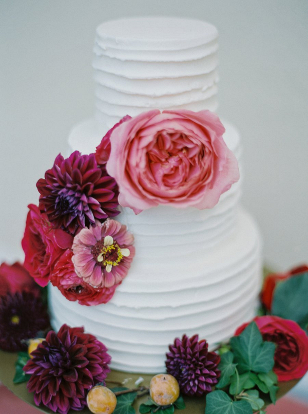 Floral covered white wedding cake