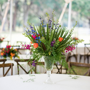 Colorful palm leaf wedding centerpiece