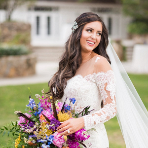 Bride with oversized colorful bouquet and off the shoulder lace gown