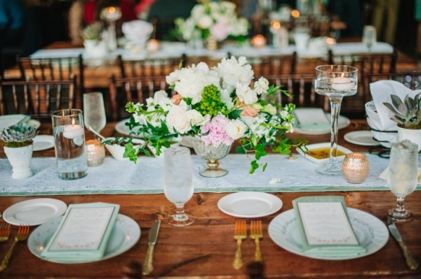 Pink and white centerpiece with greenery accents
