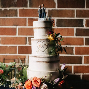Semi naked wedding cake with carved heart