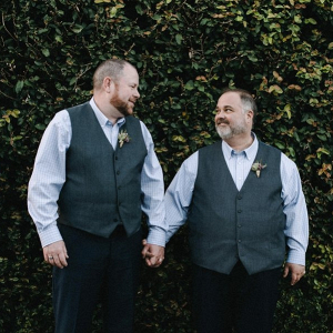 Grooms in gray wool vests