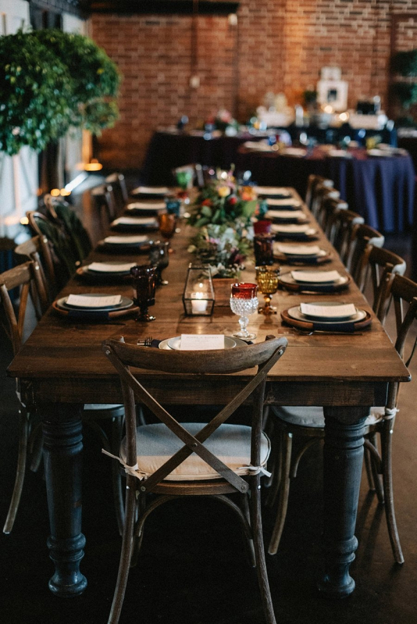 Colorful farm table wedding reception with wood box centerpieces
