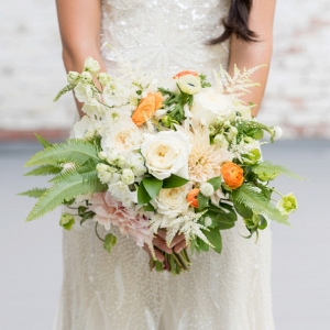 White and orange bouquet with greenery