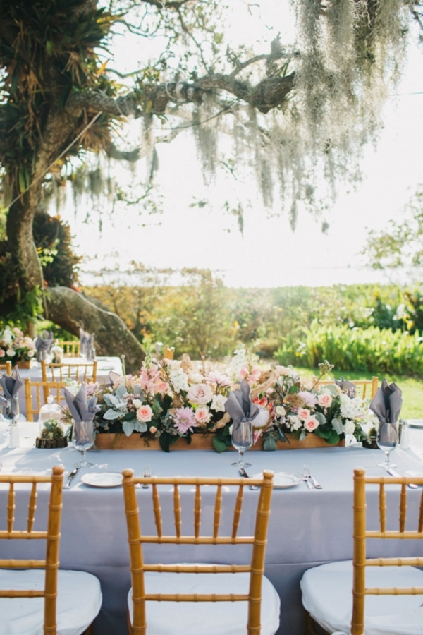 Eclectic pink and gray tablescape with wood details