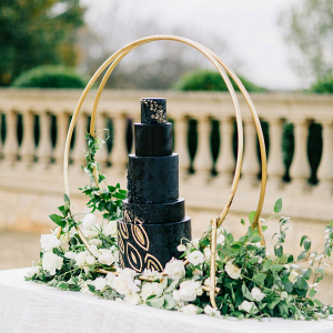 Elegant black and gold wedding cake