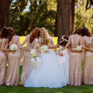 Bridesmaids in rose gold metallic dresses