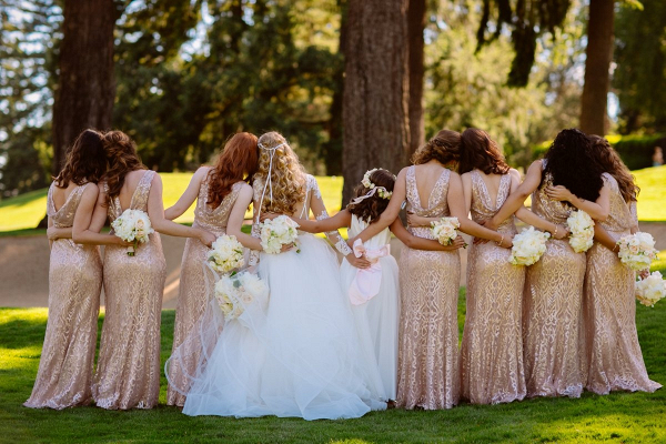 Bridesmaids in rose gold metallic dresses
