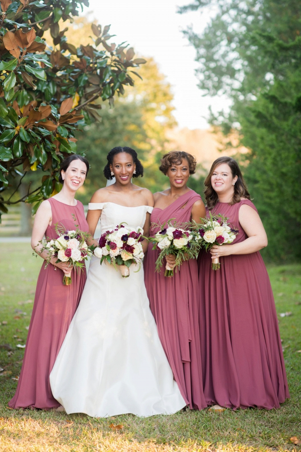 Bridesmaids in mauve red gowns