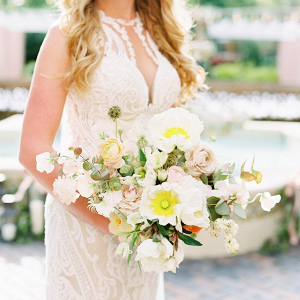 Peach, white, and yellow bridal bouquet