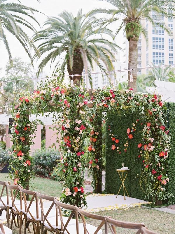 Floral covered ceremony arbor