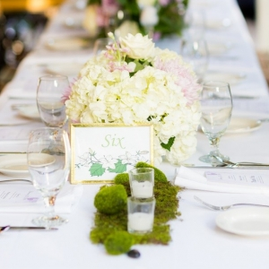 Lavender and white centerpiece with moss accents