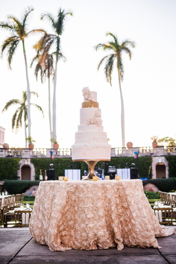 Tall white and gold wedding cake