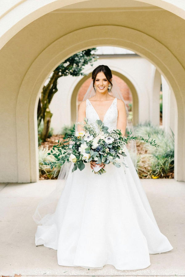 Bride with oversize white and greenery bouquet