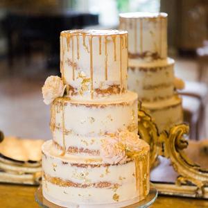 Gold and white drip cake