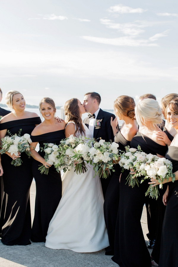 Bridesmaids in black off the shoulder dresses