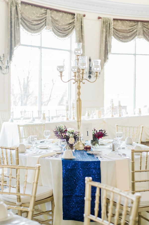 Elegant reception table with candelabra and sequin runner