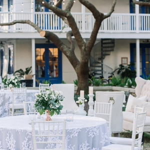 Outdoor wedding reception with lace linen overlays