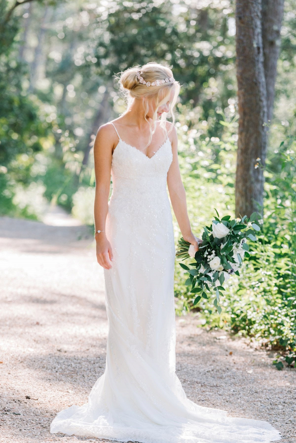 Bride in lace spaghetti strap dress