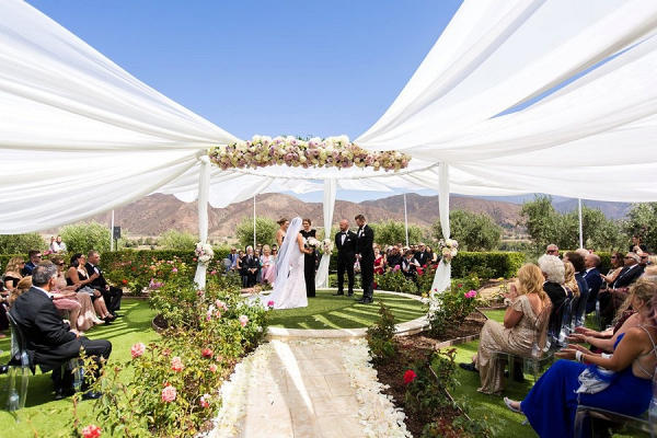 Dramatic circle wedding ceremony with draping