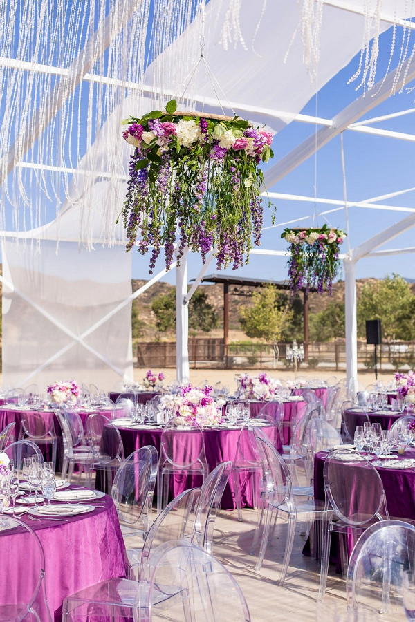 Open tent wedding reception with floral chandeliers