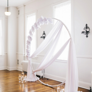 Draping and paper flower ceremony arch